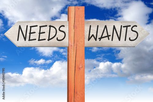 Fotografía  Wants or needs - wooden signpost