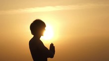The Man Rise His Hands And Namaste At Sunset.