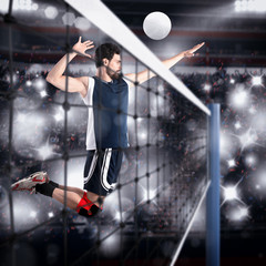FototapetaVolleyball player hits the ball