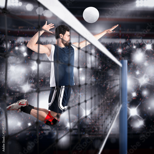 Volleyball player hits the ball - 110455311