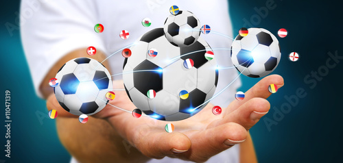 Photo  Businessman holding football in his hand