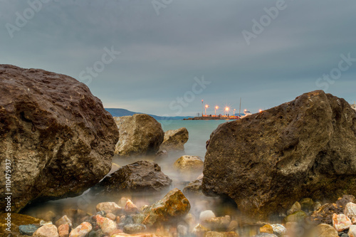 Photographie  Long exposure of a rocky beach at Oropos in Greece.