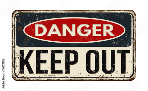 Photo  Danger keep out rusty metal sign