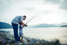 Son And Dad Fishing At Dam,vin...