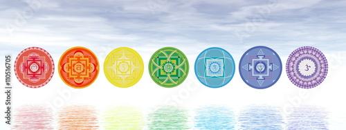 Fotografia  Seven chakra symbols line - 3D render