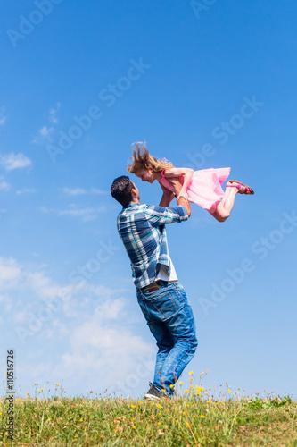 Fotografie, Obraz  Daddy spinning around his daughter
