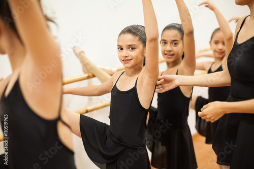 Fényképezés  Pretty girl enjoying her ballet class at school