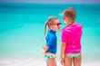 Kids having fun at tropical beach during summer vacation
