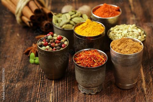 Fotografie, Obraz  variety of spices (saffron, paprika, pepper, fennel, cinnamon, turmeric, nutmeg)