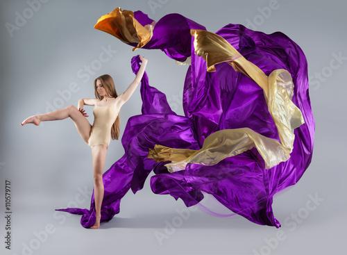 beautiful young girl dancing. Flowing fabric Obraz na płótnie
