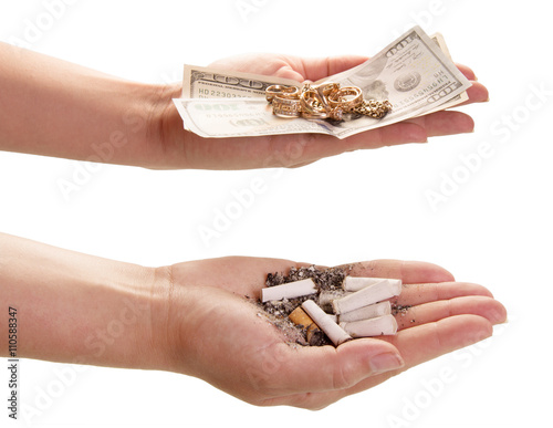 Fotografie, Obraz  Price smoking. Cigarette butts and money in hands