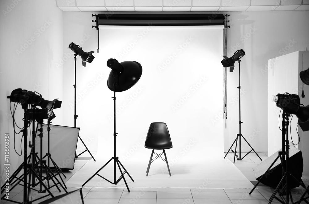 Fototapety, obrazy: Empty photo studio with lighting equipment