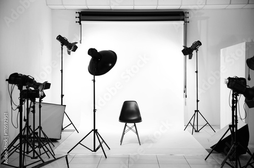 Fototapeta  Empty photo studio with lighting equipment
