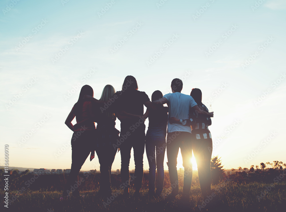 Fototapety, obrazy: Group of people hugging outdoors; sunset
