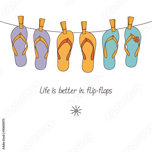 Cute flip-flops hanging on clothesline for summertime design