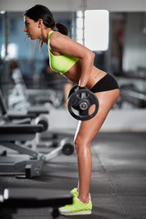 FototapetaWoman doing barbell rows