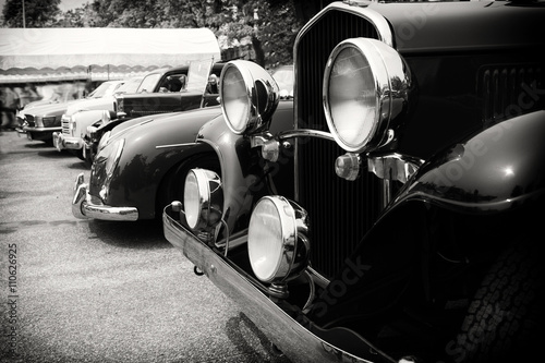 Black and white photo of classic car- vintage film grain filter effect styles