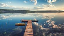 Small Dock And Boat At The Lake