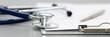 Leinwanddruck Bild - Stethoscope head lying on medical form on clipboard pad