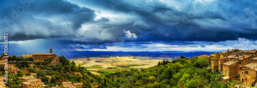 Foto op Canvas Blauwe jeans Montalcino, old historic medieval town, Italy. Tuscan landscape in the background - panorama