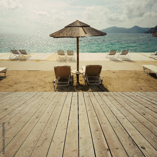 Fototapety, obrazy: Wooden deck terrace over sea beach and sky. Summer vacation background. Retro filter effect