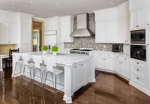 Kitchen in New Luxury Home with White Cabinets, Hardwood Floors, and Stainless S Canvas-taulu