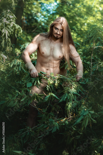 Photo  Wild man in the woods.