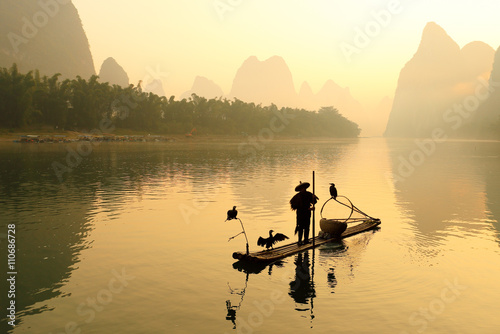 Poster Ochtendgloren Huangbu (Yellow Cloth) Beach Sunrise on Li River, Xingping, Guilin, China. Xingping is a town in North Guangxi, China. It is 27 kilometers upstream from Yangshuo on the Li River