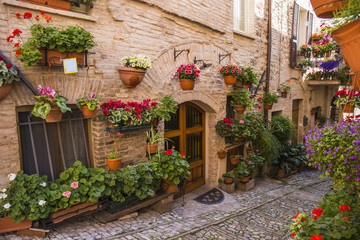 Fototapeta na wymiar Floral streets of Spello in Umbria, Italy.
