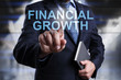 Businessman is pressing on virtual screen and selecting Financial growth.