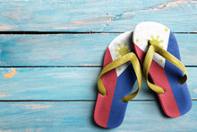 Thongs With Flag Of Philippines, On Blue Wooden Boards