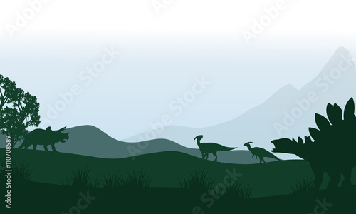 Silhouette of stegosaurus and parasaurolophus in fields Canvas Print