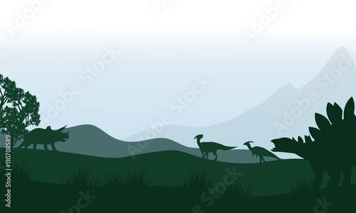 Fotografie, Obraz Silhouette of stegosaurus and parasaurolophus in fields