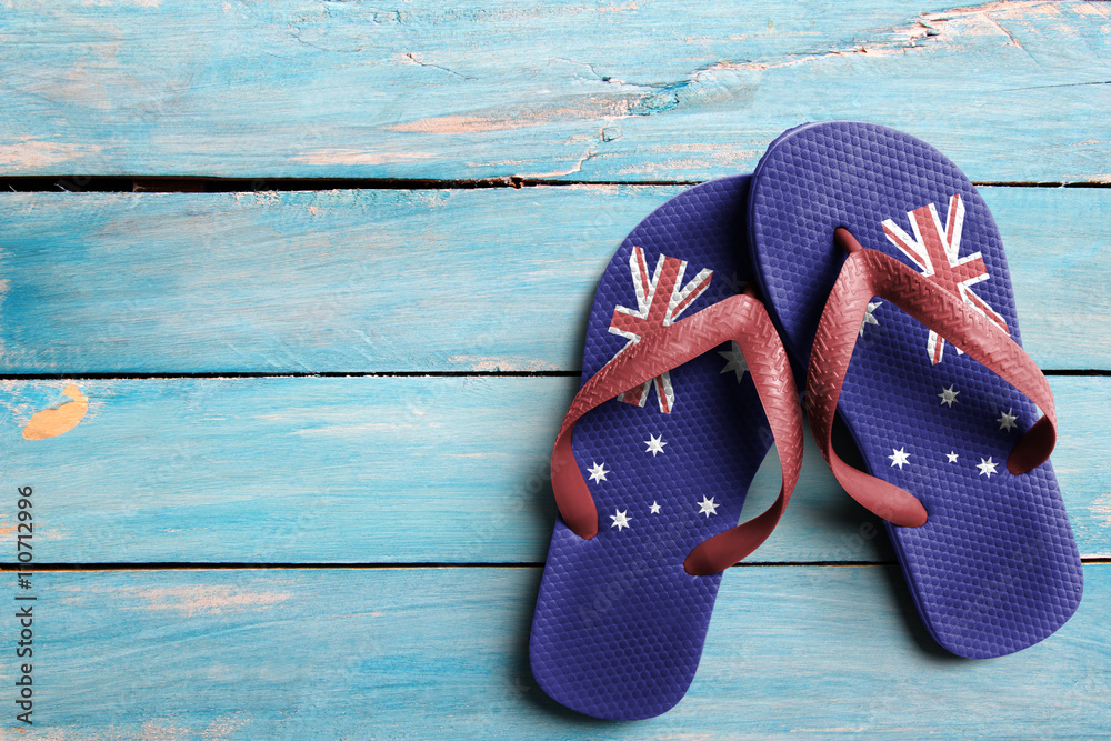 Fototapeta Thongs with flag of Australia, on blue wooden boards