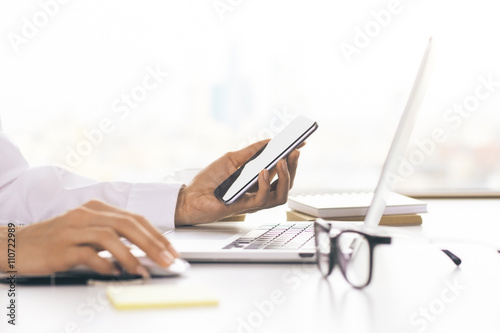 Woman using technology in office