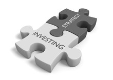 Two Connected Puzzle Pieces With The Words Investing Strategy