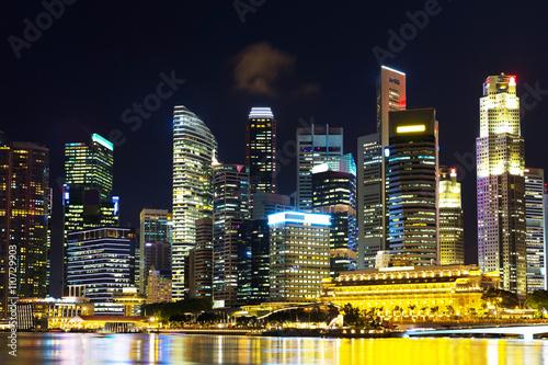 Landscape of the Singapore financial district and business buildings in lights a Poster