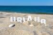 canvas print picture - Urlaub Strand Buchstabend im Sand