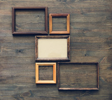 Frames On Wooden Wall