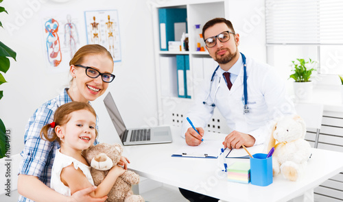 mother and child on reception at doctor - 110741913