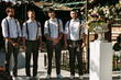 Four groomsmen with the bow-ties on the wedding ceremony