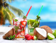 Mojito lime and strawberry drinks on wooden background