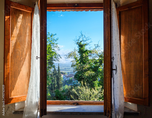 View on Tuscany through old vintage window