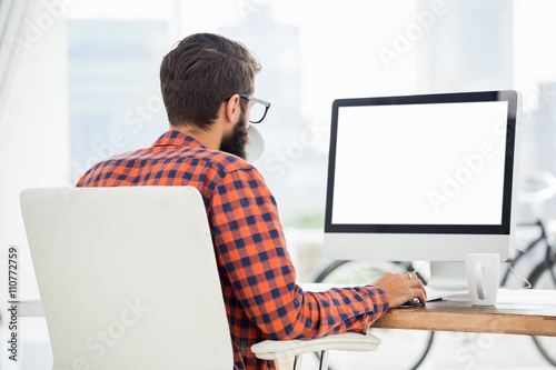 Fotografie, Obraz  Hipster using a computer