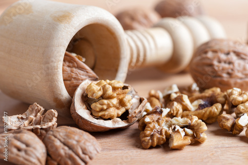 various nuts with a broken shell on rustic wood