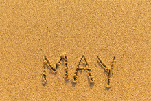 May - Word Inscription On The Gold Sand Sea Beach.