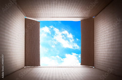 Foto  Looking on blue sky. Thinking outside the box concept