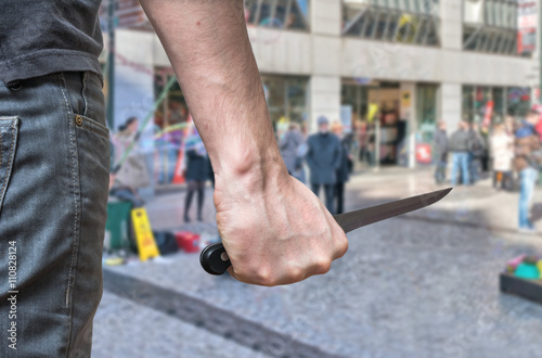 Fotografía  Murderer or killer is attacking with knife n public place.
