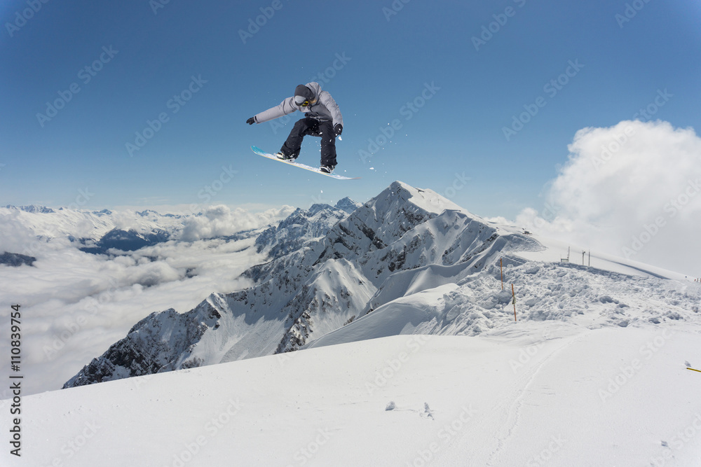 d70801225fa Snowboard rider jumping on mountains Poster