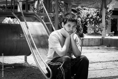 Girl pauper sitting alone at playground,black and white tone Tapéta, Fotótapéta